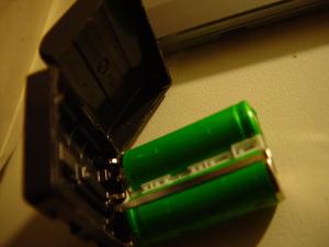 Shelled NP-FM50 Li-ion rechargeable battery